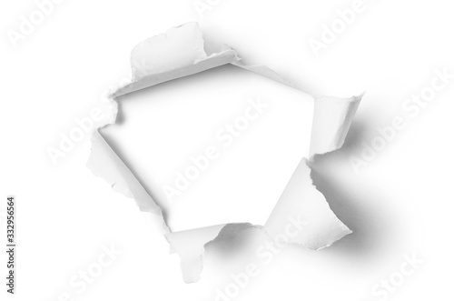 Obraz Ragged hole torn in ripped paper, isolated on white background - fototapety do salonu