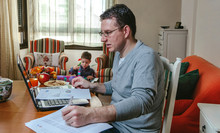 Father Working At Home While H...