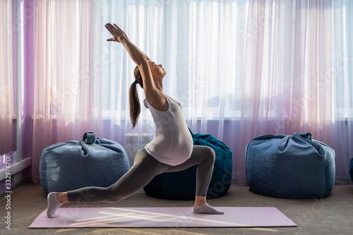 Pregnant woman practice yoga Wallpaper Mural