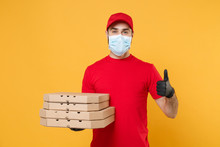 Delivery Man Employee In Red Cap Blank T-shirt Uniform Mask Gloves Give Food Order Pizza Boxes Isolated On Yellow Background Studio. Service Quarantine Pandemic Coronavirus Virus Flu 2019-ncov Concept