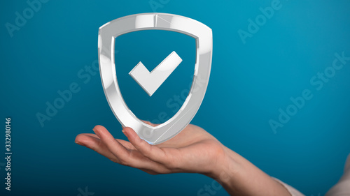 Fotografiet shield protection concept holding in hand 3d