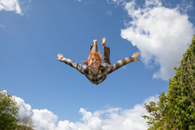 Young Boy Flying In The Air