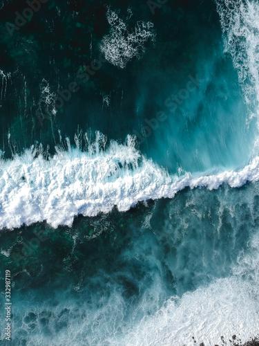 Aerial drone view of spashing waves in blue ocean Wallpaper Mural