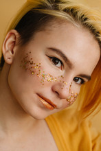 Girl With Yellow Stars Like Freckles On Her Cheeks