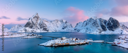 Obraz Panoramic view from above to Sakrisøya Island with mountains on background at sunrise - Lofoten Islands, Norway. Europe - fototapety do salonu