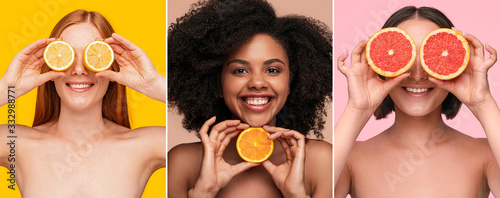Optimistic multiracial women showing fresh citruses