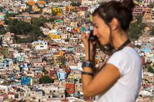 Tourist Taking Photos Of Guana...