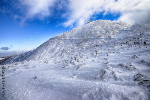 KARPACZ, POLAND - MARCH 08, 2020: Snezka or Sniezka (in Czech and Polish) is a mountain on the border between the Czech Republic and Poland. Winter landscape. Giant Mountains, Poland, Europe. #332991389