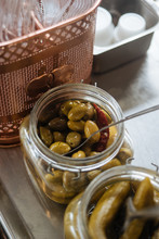 Jars With Pickles On Cafe Counter