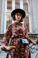 Stylish Woman With Bicycle On ...