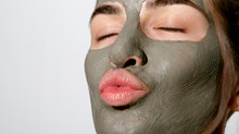 Young Female Relaxing With Facial Mask On