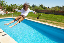 Excited Man Falling In Pool On...