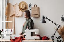 Blur Woman Dressmaker Going Near Her Workplace.