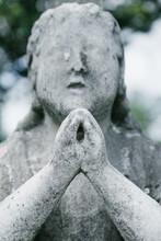 Praying Figure And Cross