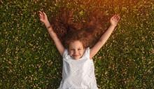 Cheerful Little Girl Lying On ...