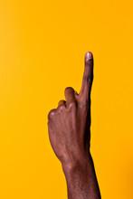 Black Man Raising Index Finger...