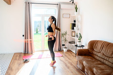 Young Woman Doing Full Body Workout At Home