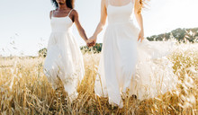 Women Dressed In White.