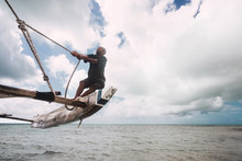 Fisherman Pulling The Rope, Keeping The Balance To Navigate His