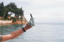 Male Hand Holding A Polaroid C...