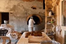 Man Baking Bread In Masonry St...