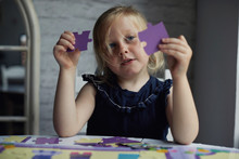 Child Doing A Jigsaw Puzzles