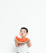 Portrait Of Boy Eating Slice Of Watermelon