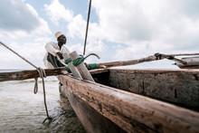 Fisherman In Zanzibar. A Fisherman In Zanzibar On A Quiet Sunny