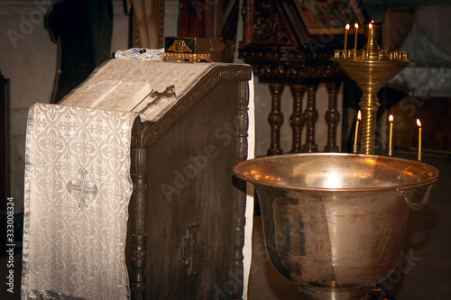 Valokuva font with three candles for the sacrament of Epiphany