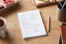 Handwritten Notes In Pad On Wo...