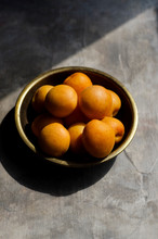 High Angle View Of Bowl Of Apricots On Table