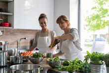 Women Preparing Food In A Kitc...