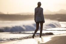 Young Woman Walking Along Ocea...