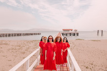 Portrait Of Women In Red Dress...