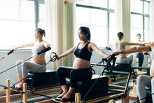 Pregnant Woman Practicing Pila...