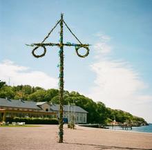 Swedish Midsummer Pole Decorated With Swedish Flags