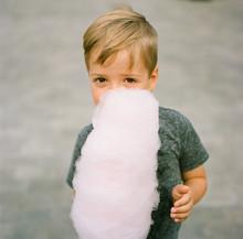 Portrait Of Boy Eating Cotton ...