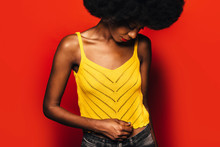 Afro Woman Posing Over Red Bac...