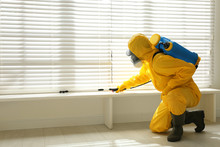 Male Worker In Protective Suit...
