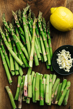 De-stemmed Asparagus With Lemon And Garlic On A Cutting Board