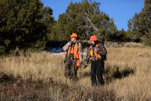 Two Female Hunters Hike In A M...