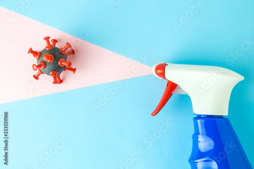 Flat lay of pump sprayer and covid-19 cell, coronavirus prevention abstract Canvas Print