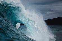 A Powerful Wave Breaks Under A...
