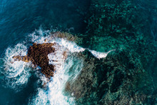 Aerial View Of A Wave Breaking Over A Sharp Lava Reef In Tenerife.