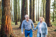 Happy Retired Couple Enjoying Time In Nature.