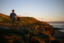 Two Children Walking On Rocks ...