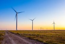 Wind Turbines In Field Against...