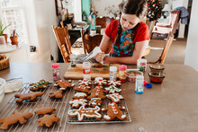 Girl Decorating Christmas Cook...