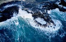 Waves Crashing Over Coastline ...