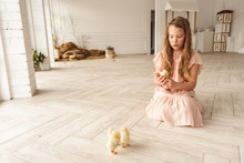 Girl Playing With Ducks For Ea...